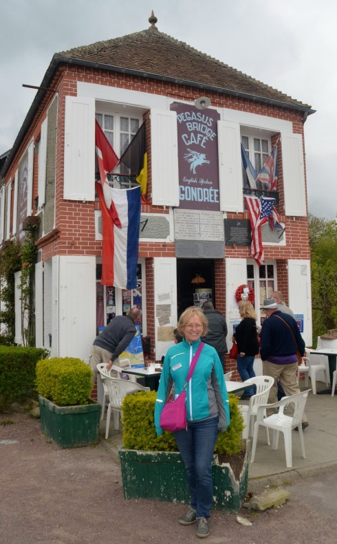 Alison in front of the first house liberated at Pegasus Bridge