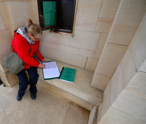 Signing the Guest Book at Ranville War Cemetery