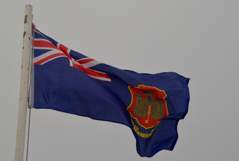Flag on to of the Rock of Gibraltar