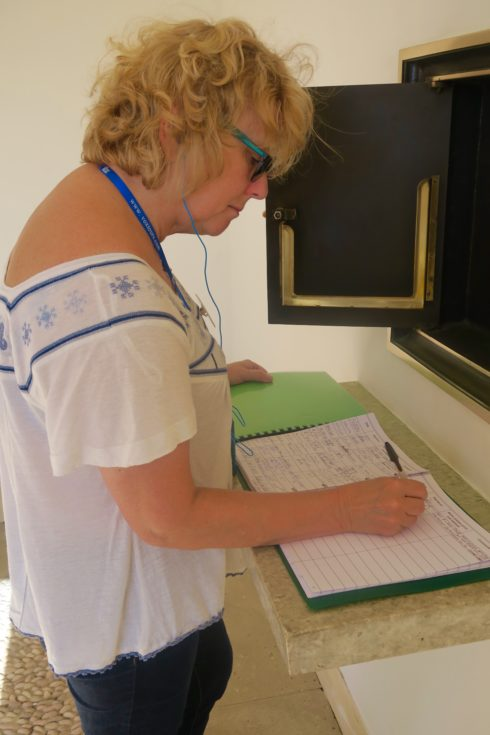 Alison Signing the Agira Guestbook
