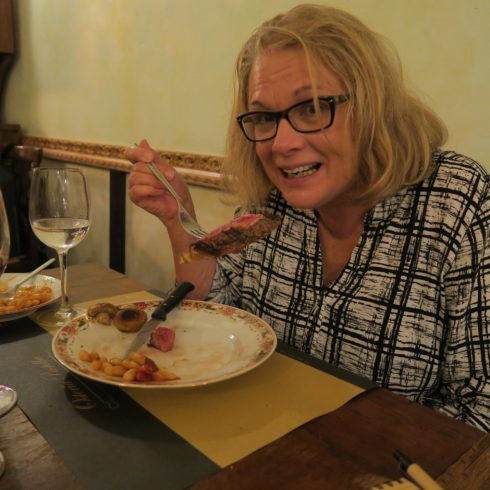 Anne Digs into her Florentine Steak