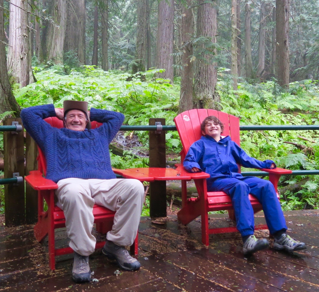 Relaxing in Hemlock Grove Red Chairs, Glacier National Park